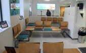 A bright spacious waiting area features a refreshments station with seats for 40 clients at a time thumbnail
