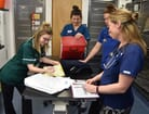 FIGURE 1 The team gather to discuss the day's cases (left to right: Hattie, Cassie, Grace and Nicola)